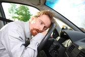 Driver sleeps in a car — Stock Photo