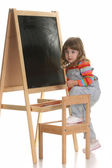 Little girl climbing on a chair — Stock Photo