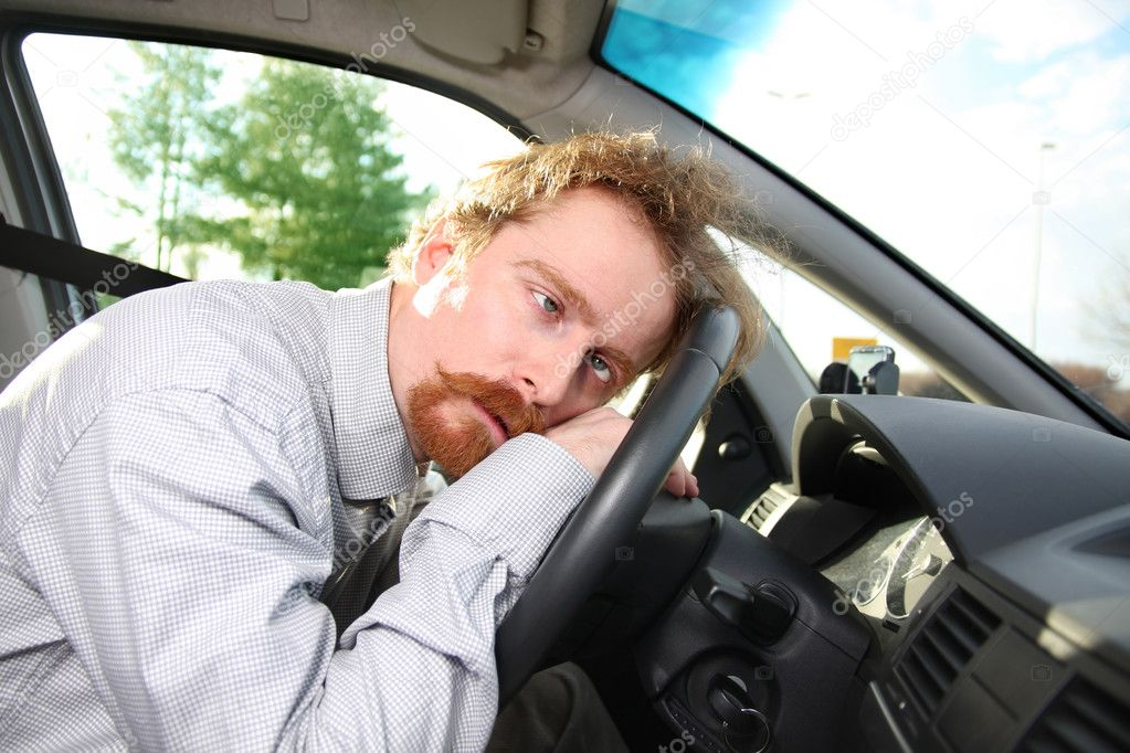 Tired driver sleeps in a car  Stock Photo #1692821