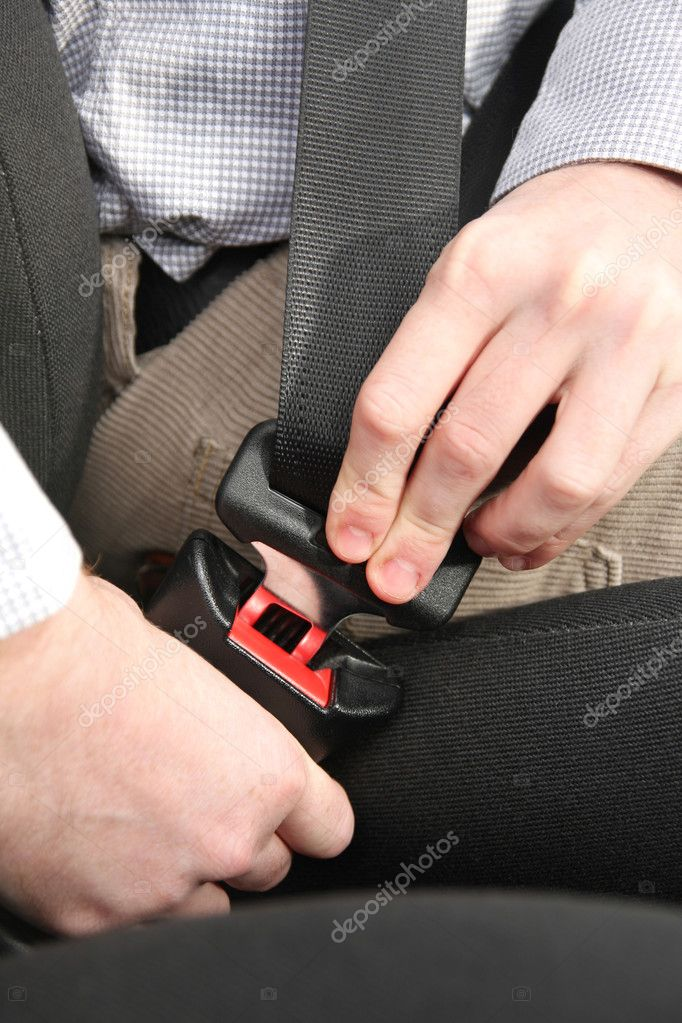 Details of hands putting on safety belt — Stock Photo #1693320