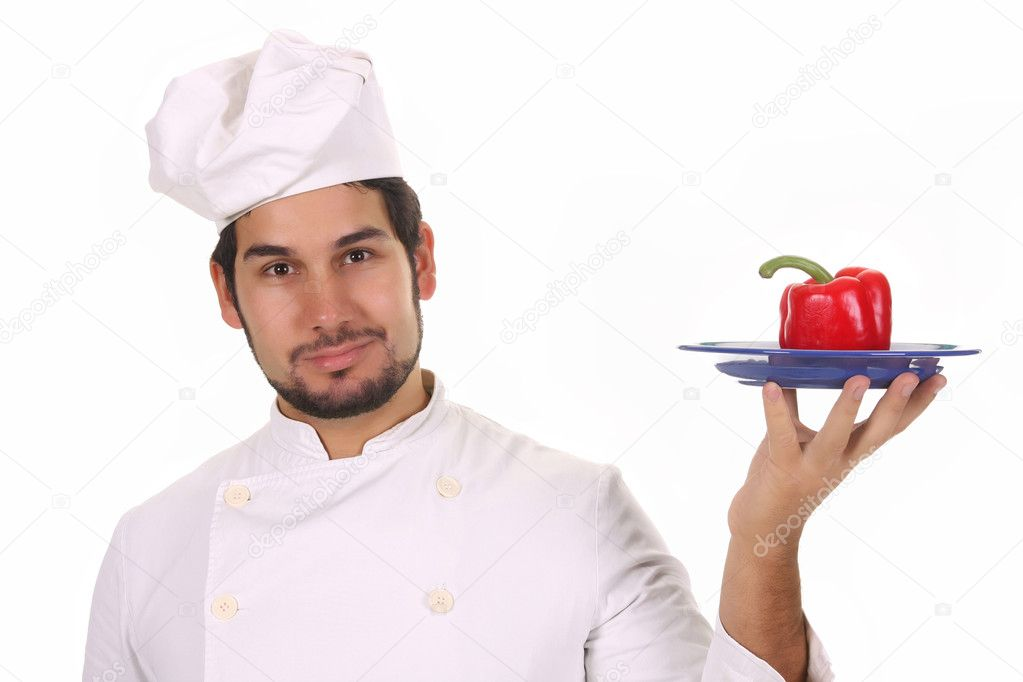 Young chef holding plate with fresh pepper — Photo #1696228