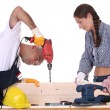 Construction workers at work - Foto Stock
