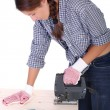 Woman carpenter at work - Stock Photo