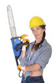 Beauty woman with chainsaw — Stock Photo