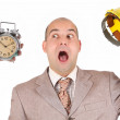 Businessman looking at clock alarm — Stock Photo