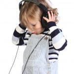 Beauty a little girl listening music — Stock Photo