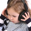Little girl listening music — Stock Photo