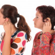 Two womputting hearing aid into ear — Stock Photo #1787755