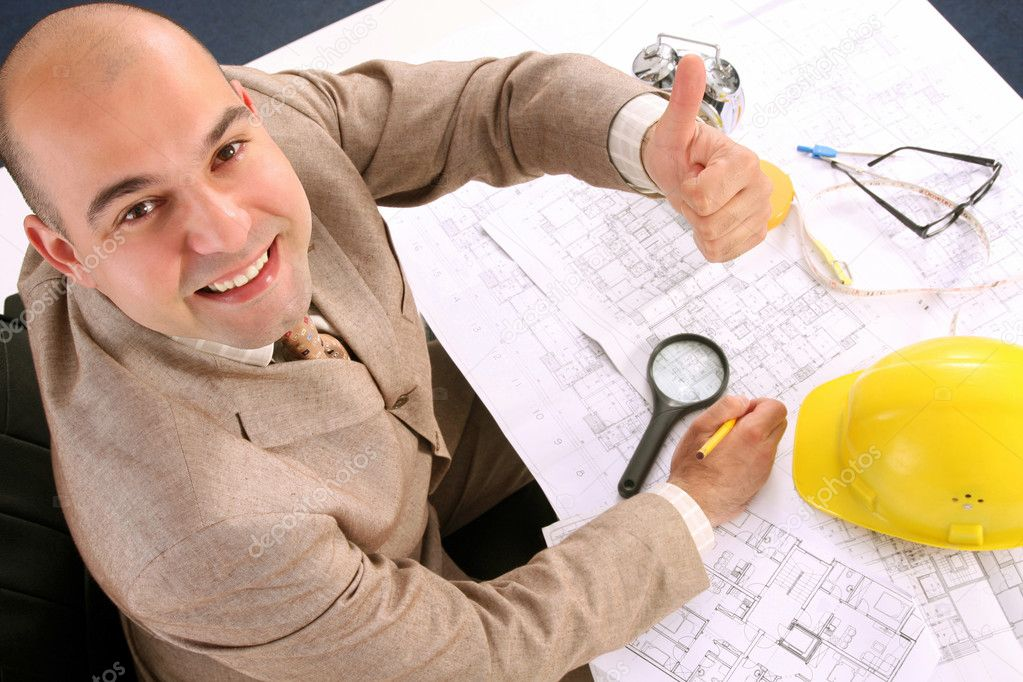 A businessman happiness with architectural plans at desk — Stock Photo #1785941