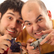 Two young men playing video game - Foto Stock