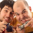 Two young men playing video game - Stock Photo