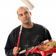 House painter with paint roller — Stock Photo
