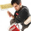 House painter thinking with paint roller - Stockfoto