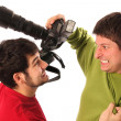 Two Professional photographers fighting — Stock Photo #1909860