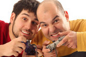 Two young men playing video game — Stok fotoğraf
