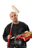 House painter with paint roller — Stockfoto