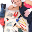 Woman carpenter with work tools - Stock Photo