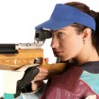 Woman aiming a pneumatic air rifle — Photo