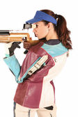 Woman aiming a pneumatic air rifle — Stockfoto