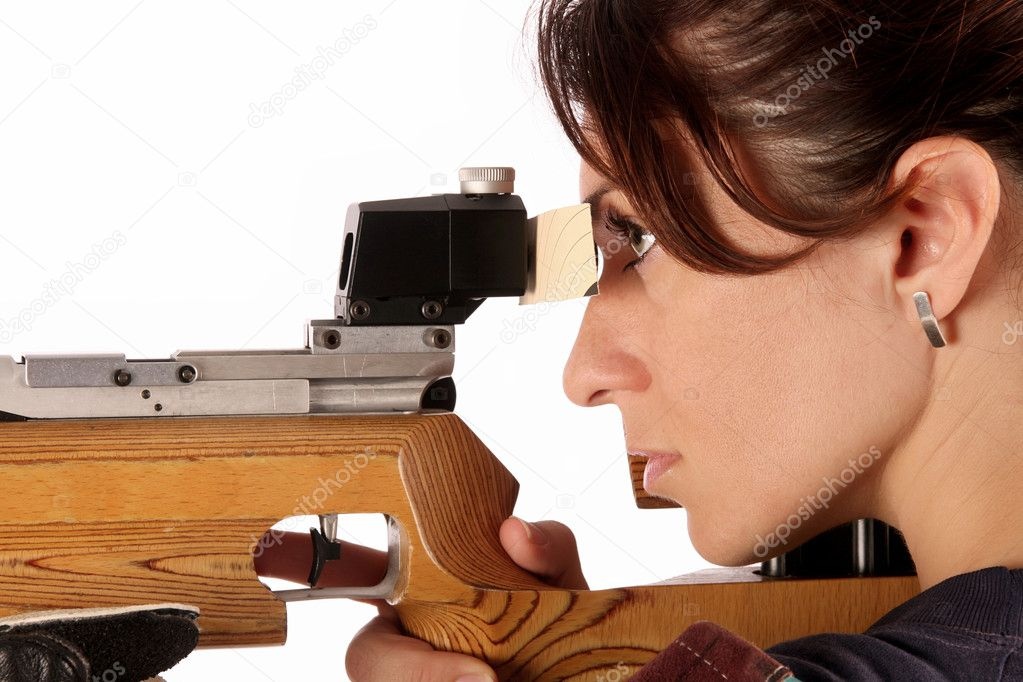 Beautiful young woman aiming a pneumatic air rifle — Stock Photo #1912077
