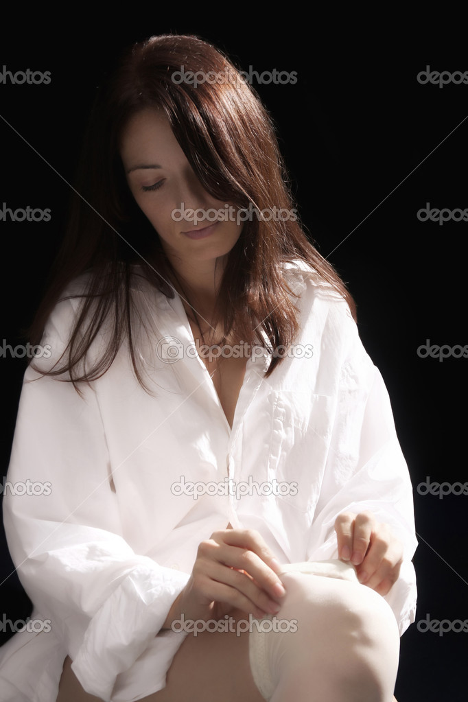 Beautiful young woman putting on white stockings  — Foto Stock #1916812