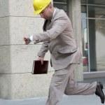 A businessman panic running — Stock Photo #2180529