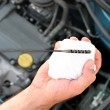 Checking engine oil dipstick in car — Stock Photo #2181997