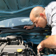 Checking the engine of a car — Stock Photo #2182807