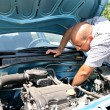 Stock Photo: Checking engine of car