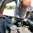 Stock Photo: Checking the engine of a car