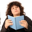 Stock Photo: Boy reading a book
