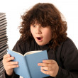 Boy surprised and many books — Stockfoto