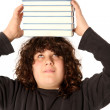 Boy with books on head — Stock Photo #2185257
