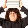 Boy with books on head — Stock Photo