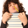 Stock Photo: Boy with pencil and books