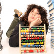 Boy with abacus calculator with colored beads and books — Stock Photo #2185682