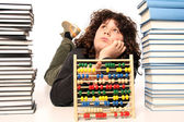 Boy with abacus calculator with colored beads and books — Stock Photo
