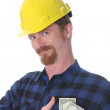 Construction worker with earnings — Stock Photo