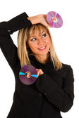 Woman holding compact disc — Stock Photo