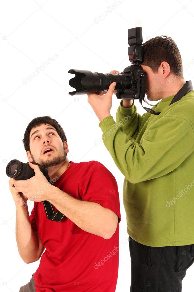 Professional photographer in action on white background — Stock Photo #2440022