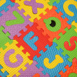 Alphabet puzzle background — Stock Photo