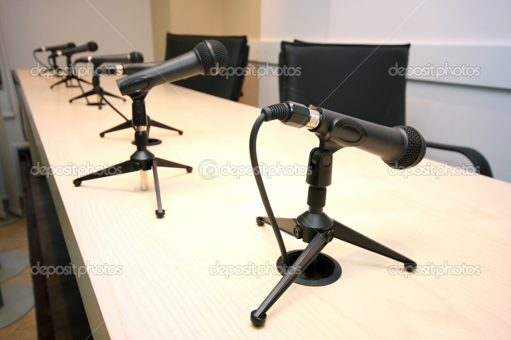 Press Conference, conference room with microphones in row — Stock Photo #2559140
