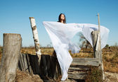The bared girl model under a white veil — Stock Photo
