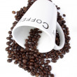 Coffee cup with coffee beans — Stock Photo
