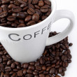 Stock Photo: Coffee cup with coffee beans