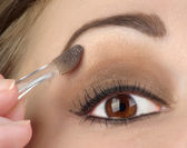 Women eye with brown makeup — Stok fotoğraf