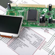 Foto Stock: Display and circuit board with schemati