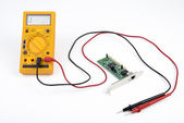 Multimeter and circuit board — Stok fotoğraf