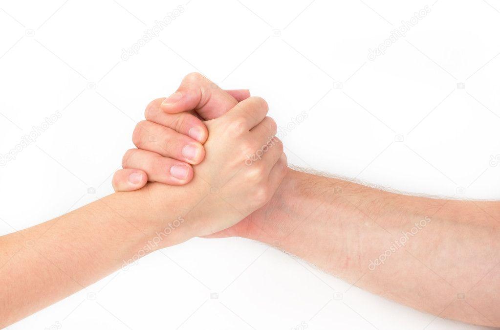 При рукопожатии человек держит свою руку сверху