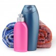 Cosmetic bottles and towels — Stock Photo